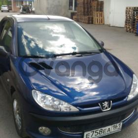 Peugeot 206 1.4 MT (75л.с.)