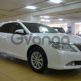 Toyota Camry, VII (XV50) 2.5 AT (181 л.с.) 2013 г.