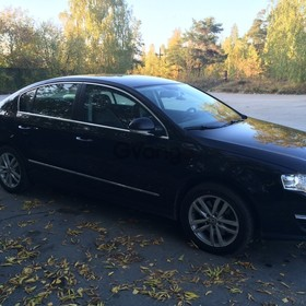 Volkswagen Passat 1.8 AT (152 л.с.) 2009 г.