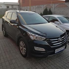 Hyundai Santa Fe 2.2d AT (197 л.с.) 4WD 2014 г.