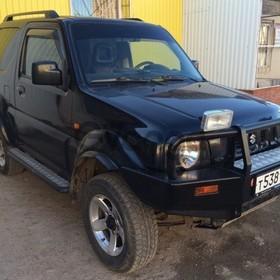 Suzuki Jimny 1.3 AT (85 л.с.) 4WD 2005 г.