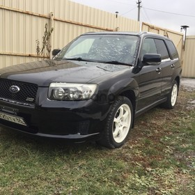 Subaru Forester 2.0 AT (140 л.с.) 4WD 2005 г.